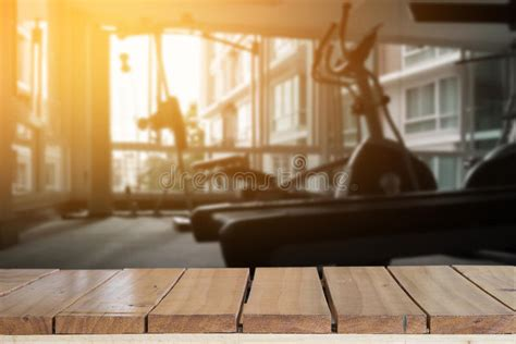 empty top wood table  blur fitness gym background