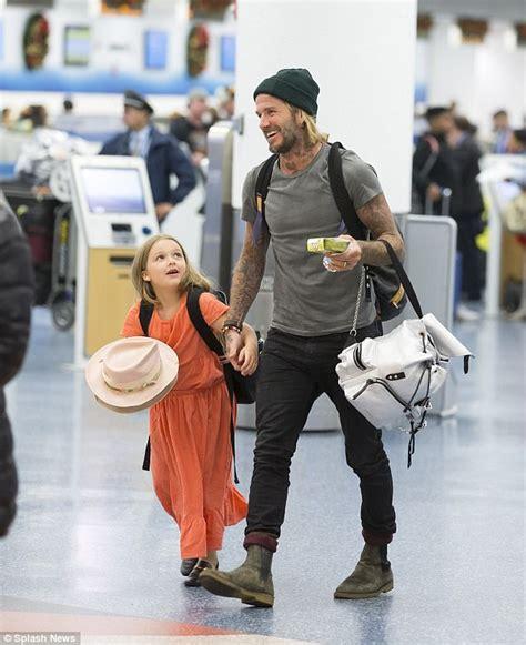 Harper Beckham gazes at dad David after New Year's getaway