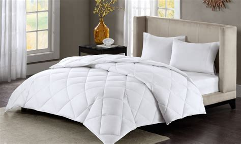 down comforters on sale how to pick the right fill for down comforters overstock com
