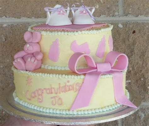 Pink And Yellow Baby Shower Cake by Yellow Baby Shower Cake With Baby Shoes Topper And Rabbit With Big Pink Bowl Png 2 Comments