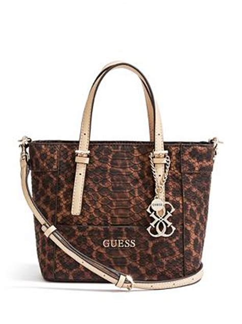 Guess Delaney Mini Palm your favorite mini bag takes on an new look with