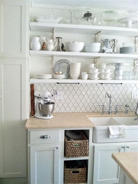 white cottage style kitchen with open shelving and a kitchen brick backsplashes for warm and inviting cooking