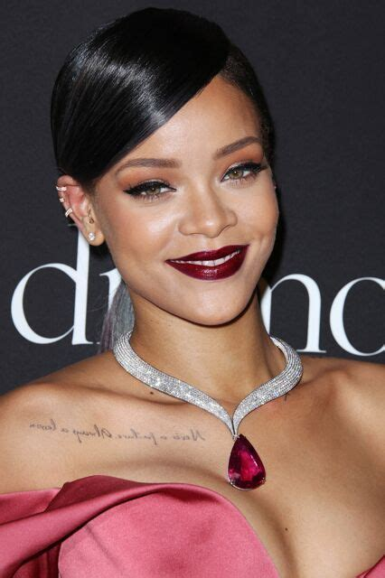 Rihanna Shows Us How Bangs Are Meant To Be Worn by 14 Times Rihanna Made Us Want To Wear Rainbow Lipstick