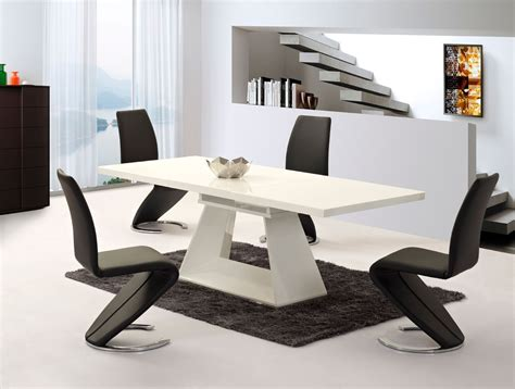 Extending white high gloss dining table and 8 black chairs