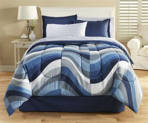 blue patterned bedspread dark blue and cream stripped on the white base bedding