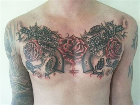 rose gun tattoo guns and roses chest tattoos