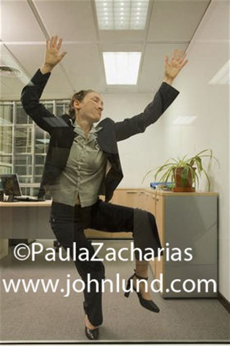 Picture Of A Business Woman Pressed Up Against A Glass Wall Running Into Glass Door