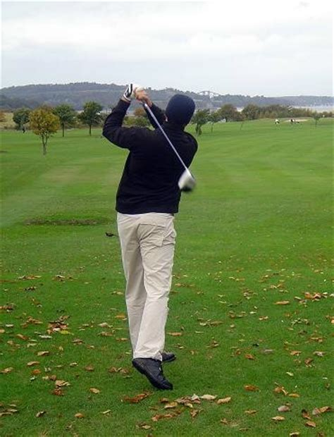 golf swing hitting down on the ball how to hit down and through the golf ball golf training tip