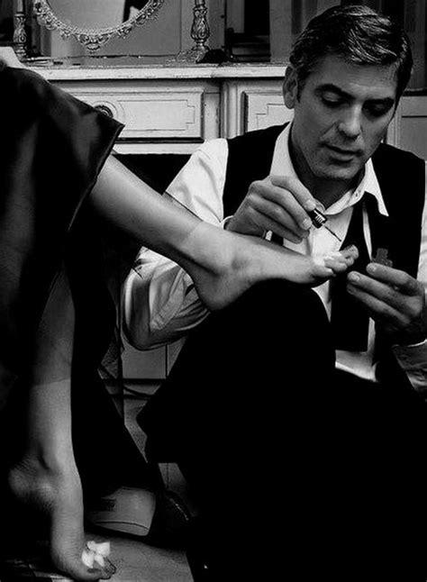 George Clooney painting Catherine Zeta Jones' toes