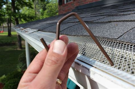 christmas light gutter hangers brown hook to hang lights on gutters with mesh leaf guard the brown hook