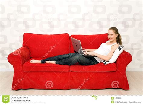 lying on couch woman lying on couch with laptop stock image image 11918881
