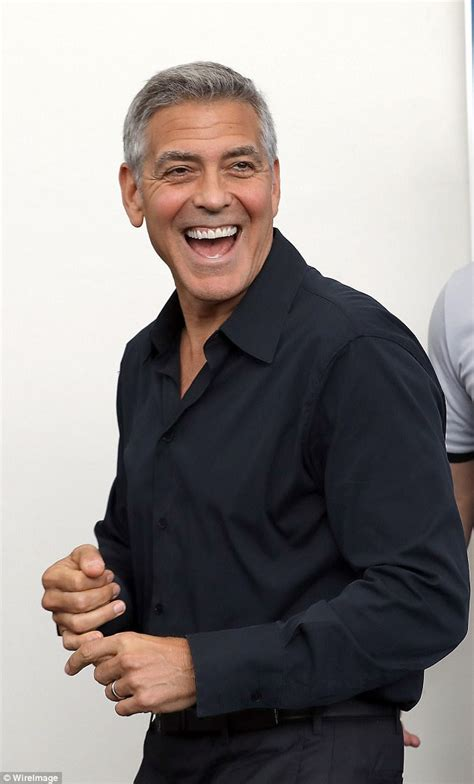 George Clooney And Say It Isnt So by New George Clooney Carries A Backpack As He Leaves