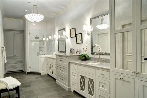 grey tile floor with white cabinets white traditional bathroom with gray tile floors this