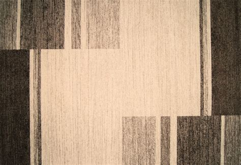 Briers Home Decor Infinity Frieze Tan Area Rug With An Offset Striped