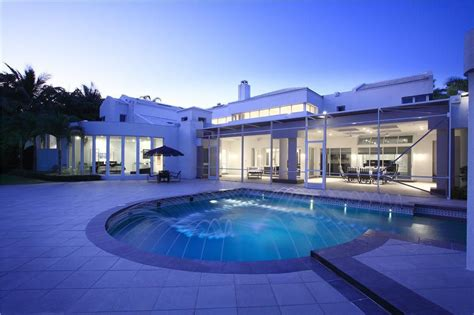 modern swimming pool with infinity pool french doors modern swimming pool with exterior stone floors transom