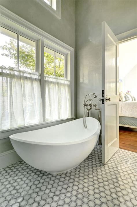 egg shaped bathtub egg shaped tub under window dressed in pink and gray drapes transitional bathroom