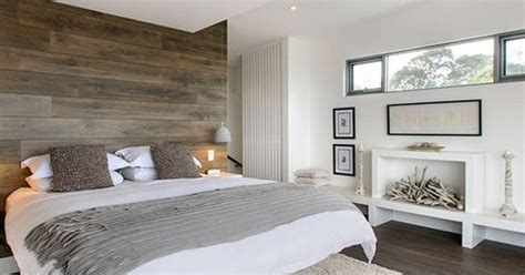 you can put laminate flooring on a wall for a stunning