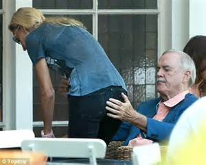 actress who played polly in fawlty towers 71 year old monty python star john cleese very public