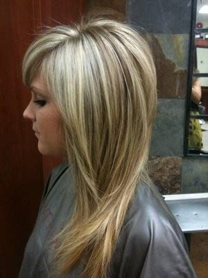 lowlighting the hair the top layer long layered hair cut and dark blonde highlights hair