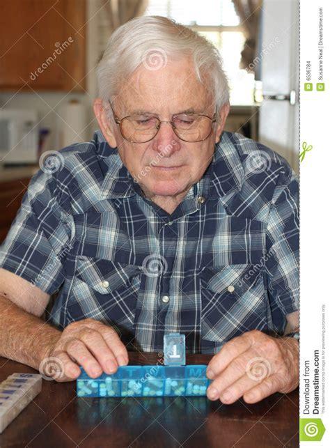 Senior Male Checks Pill Box Stock Photo   Image of