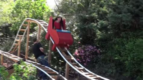 diy backyard roller coaster amazing dad builds a roller coaster for his son in backyard