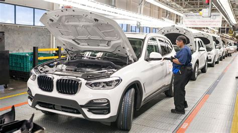 bmw factory assembly line bmw to build ice hybrid electric versions on same