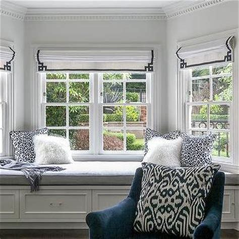 bedroom bay window seat white and navy bedroom with navy chinoiserie table next to
