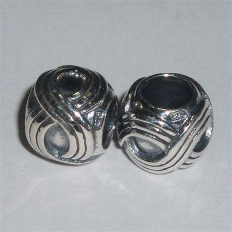 fair isle silver bead representing intricate fair isle