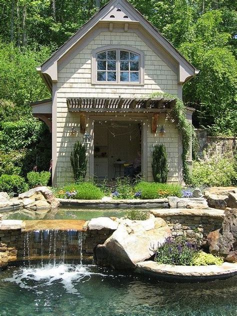 tiny pool house stunning relaxing garden and backyard waterfalls small two storey white wooden cottage with