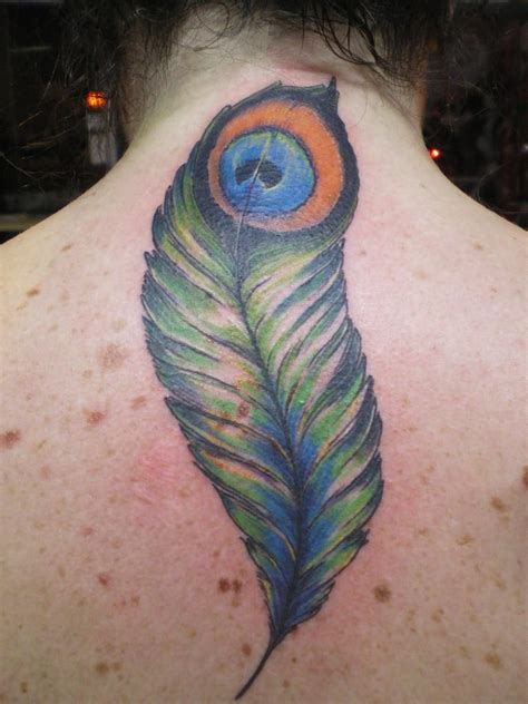 peacock back tattoo feather tattoos tattoostime