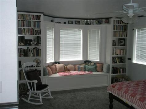 bay window seat and bookshelves built in shelving units