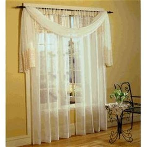 drape curtains over rods how to drape a scarf over a curtain rod ehow
