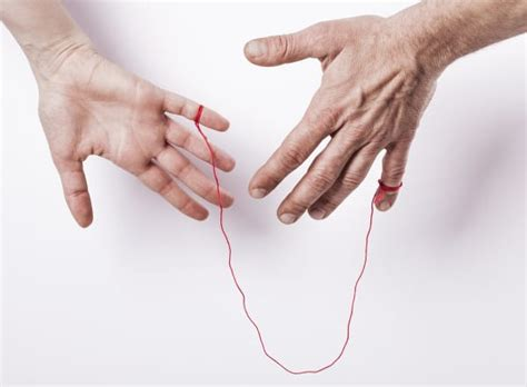 red string of fate tattoo couples strings on their fingers as a