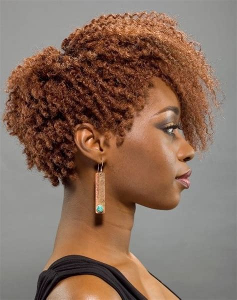 a natural afro cut style long on top and the sides and back on the hair is cut very low for a black lady to wear with pics 26 sure fire short afro hairstyles cool hair cuts