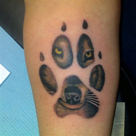 wolf paw print tattoo wolf paw print pictures to pin on tattooskid