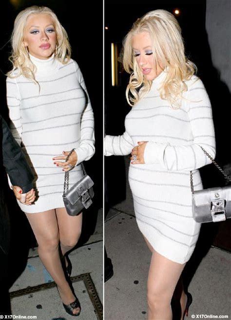 Pregnant Christina Aguilera wraps her baby bump in warm