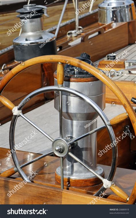 old boat navigation tools detail of an old fashioned boat deck with rudder compass