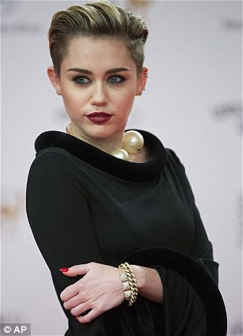 Drss 308 Mily Top miley cyrus covers up for once as she wears black maxi