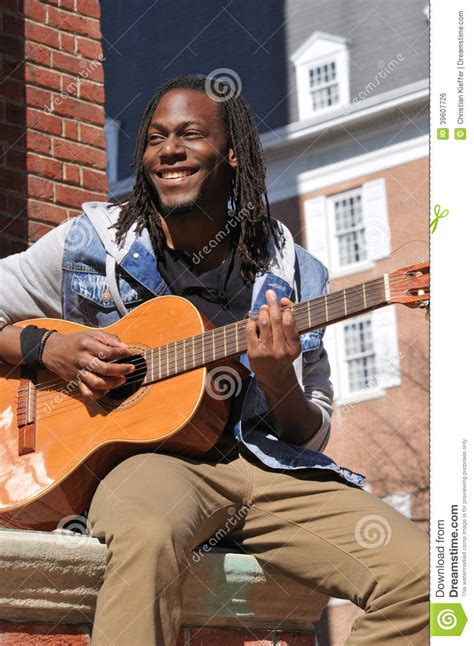 who is the guy that plays guitar and sings on the new direct tv commercials young guy playing guitar in the city stock photo image