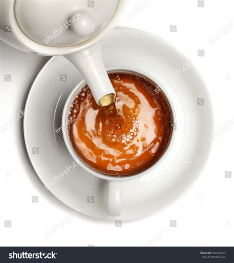 330ml Cup Of Tea Isolated tea being poured into tea cupisolated stock photo