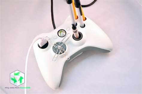 video game controllers repurposed as useful desk organizers