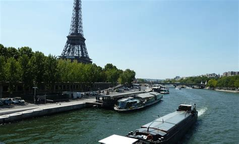 boat from eiffel tower to louvre 2 bedroom apartment near louvre in paris with seine river view