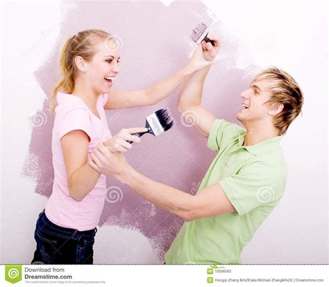 Home Plans With Prices Couple Play Fighting With Paint Stock Photos Image 10596093