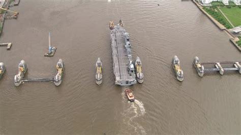 thames barrier deployed hms ocean squeezes through thames barrier bbc news