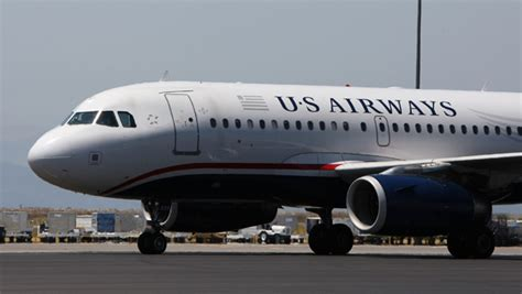 united airlines change fees united us airways raise ticket change fee cbs news