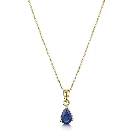 9ct yellow gold blue sapphire pendant and 18 inch chain