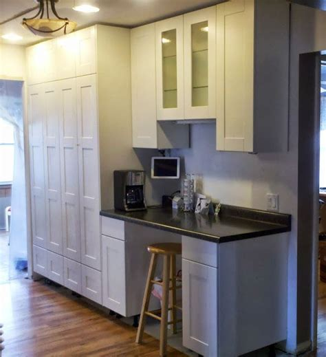how to level kitchen base cabinets how to extend tall akurum cabinet base unit for floor to