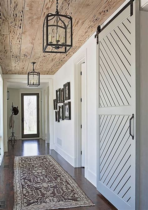 beach home bedroom with pecky cypress barn door on rails 20 stylish barn doors ideas for your interiors shelterness