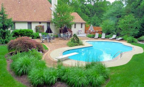 pool landscaping designs 15 pool landscape design ideas home design lover