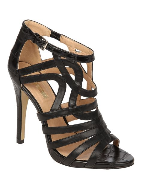 norman black high heel cage evening shoe in black lyst